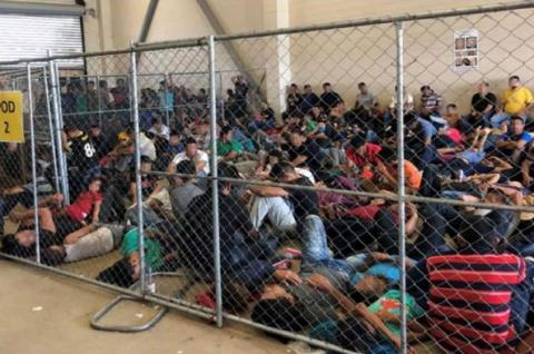 An overcrowded, fenced area holds families at a Border Patrol station in McAllen, Texas, on 10 June 2019. Reuters/Flickr.