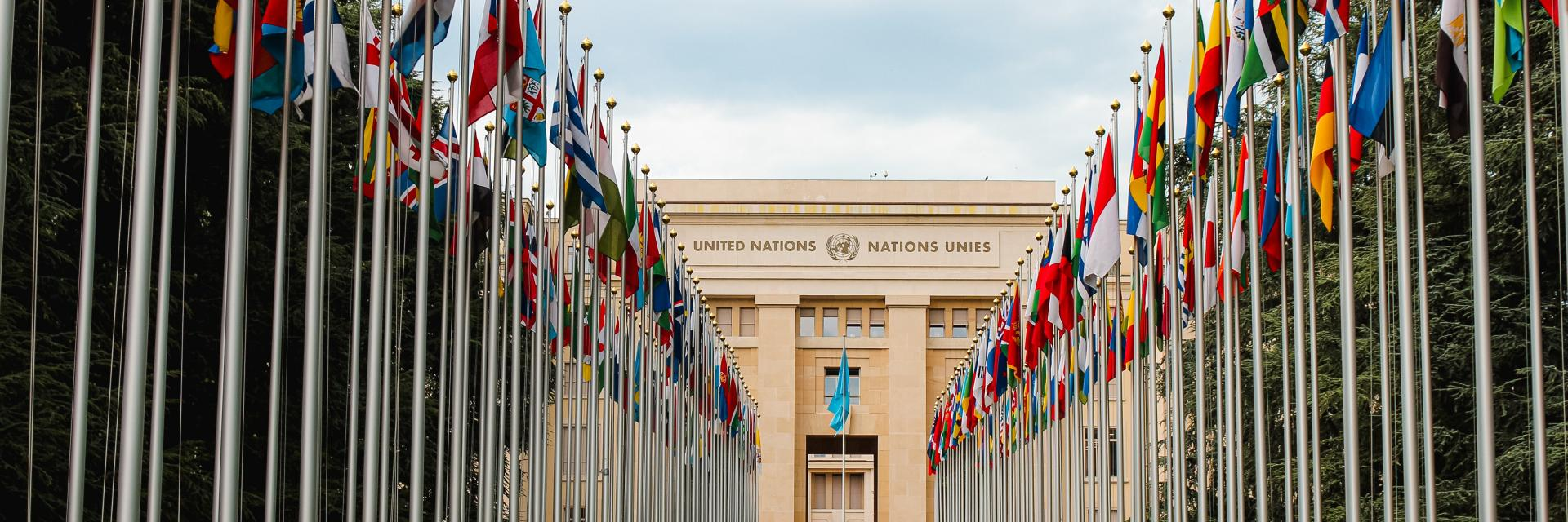 United Nations building with international flags.