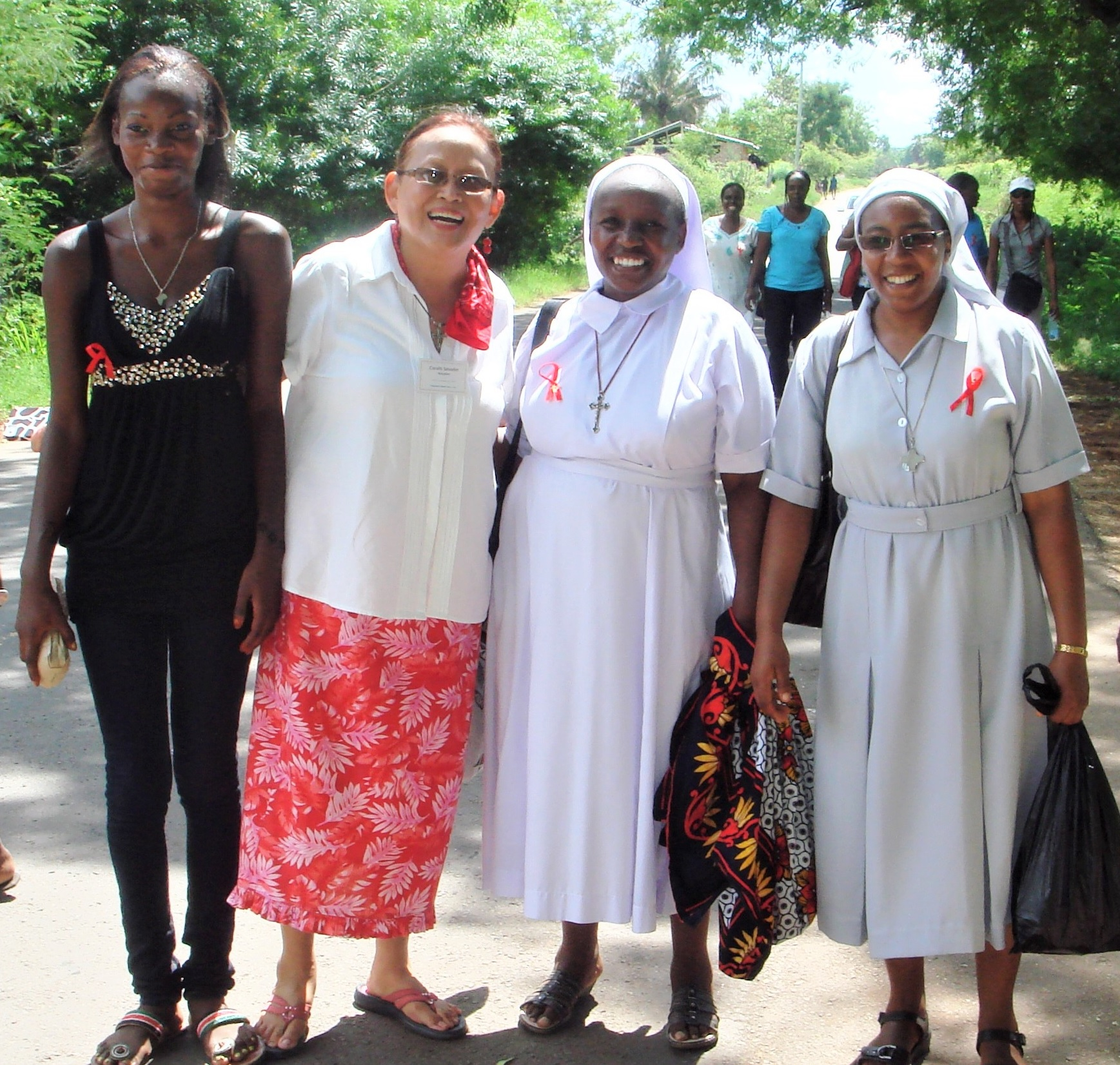 Maryknoll Lay Missioner Coralis Salvador (second from left)
