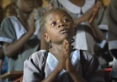 A student prays at the John Paul II School in Wau, South Sudan