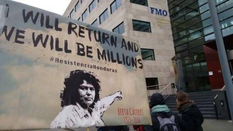 Berta Caceres demonstration at building of bank funder of dam