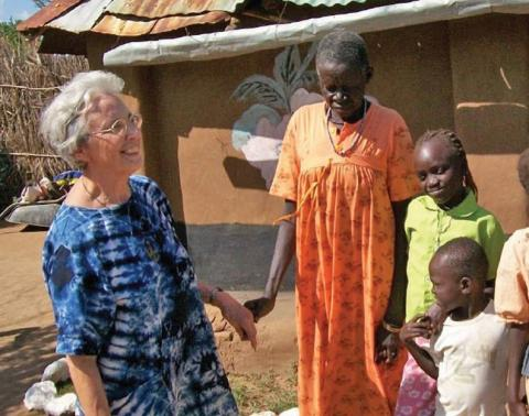 Maryknoll Sister Teresa Baldini with a family in Narus, South Sudan