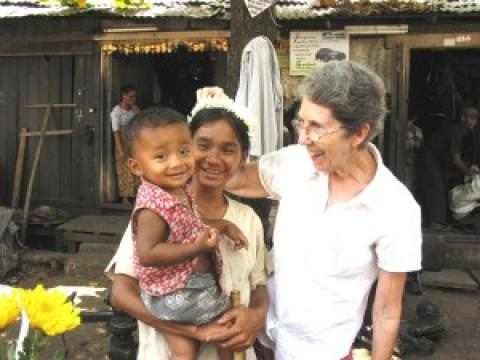 Maryknoll Sister Mary Grenough with a mother and child in Myanmar