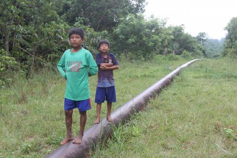 Children standing on Mongabay pipeline
