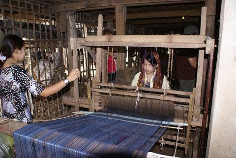 A woman at a weaving loom near Chau Doc, Vietnam