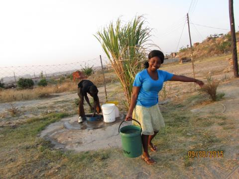 Sr. Claris' niece Tafadzwa collects water from a well in Zimbabwe.