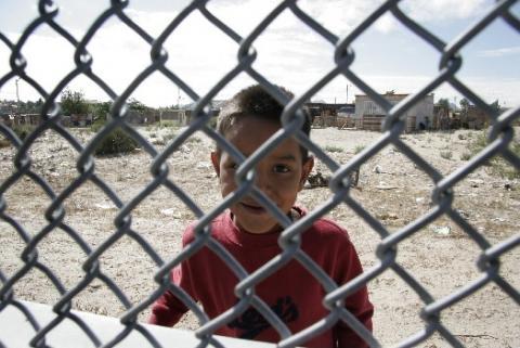 Boy behind border fence El Paso Texas