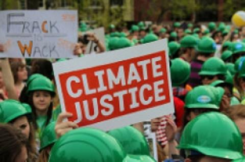 Climate justice sign in undated photo by CIDSE