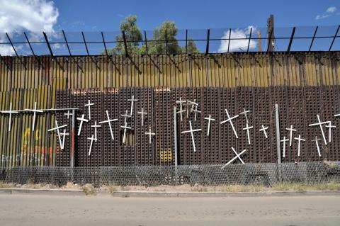 Crosses on border fence