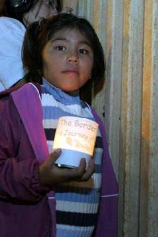 Child at prayer vigil at US-Mexico border wall