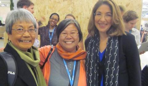 Maryknoll Sisters Becky Macugay and Marvie Misolas with Naomi Klein