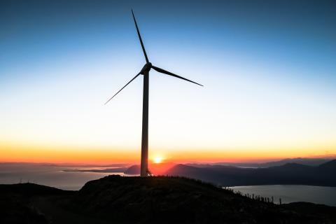 Wind turbine at sunset photo in public domain via unsplash